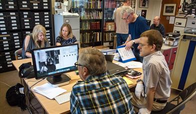 Volunteers scanning and digitising photos of jazz musicians